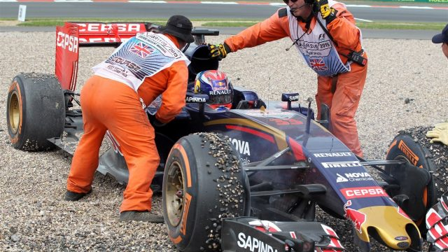 Marshals attend to Max Verstappen (NDL) Scuderia Toro Rosso STR10 after crashing into the gravel at Formula One World Championship, Rd9, British Grand Prix, Race, Silverstone, England, Sunday 5 July 2015. &copy&#x3b; Sutton Motorsport Images