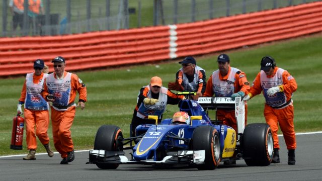 Marshals push Felipe Nasr (BRA) Sauber C34 as he breaks down on his way to the grid at Formula One World Championship, Rd9, British Grand Prix, Race, Silverstone, England, Sunday 5 July 2015. &copy&#x3b; Sutton Motorsport Images
