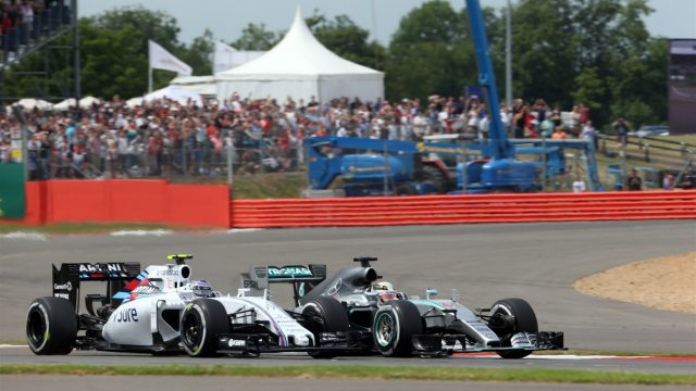 Lewis Hamilton (GBR) Mercedes AMG F1 W06 battles with Valtteri Bottas (FIN) Williams FW37 at the start of the race at Formula One World Championship, Rd9, British Grand Prix, Race, Silverstone, England, Sunday 5 July 2015. &copy&#x3b; Sutton Motorsport Images