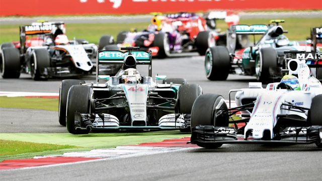 Lewis Hamilton (GBR) Mercedes AMG F1 W06 and Felipe Massa (BRA) Williams FW37 battle at Formula One World Championship, Rd9, British Grand Prix, Race, Silverstone, England, Sunday 5 July 2015. &copy&#x3b; Sutton Motorsport Images