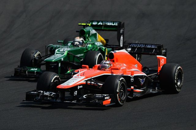 Giedo van der Garde (NDL) Caterham CT03 battles with Jules Bianchi (FRA) Marussia F1 Team MR02. Formula One World Championship, Rd10, Hungarian Grand Prix, Race Day, Hungaroring, Hungary. Sunday, 28 July 2013 &copy&#x3b; © Sutton Images