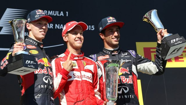 (L to R): Daniil Kyvat (RUS) Red Bull Racing, Race winner Sebastian Vettel (GER) Ferrari and Daniel Ricciardo (AUS) Red Bull Racing celebrate with the trophy on the podium  at Formula One World Championship, Rd10, Hungarian Grand Prix, Race, Hungaroring, Hungary, Sunday 26 July 2015. &copy&#x3b; Sutton Motorsport Images