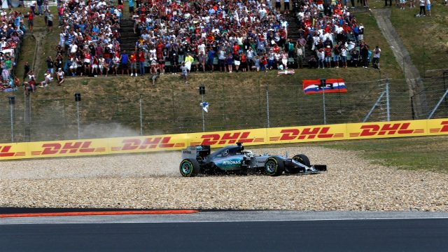 Lewis Hamilton (GBR) Mercedes AMG F1 W06 goes through the gravel on lap 1 at Formula One World Championship, Rd10, Hungarian Grand Prix, Race, Hungaroring, Hungary, Sunday 26 July 2015. &copy&#x3b; Sutton Motorsport Images