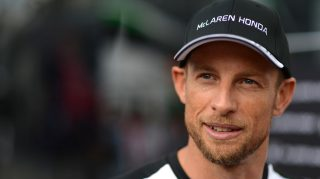Button to race on with McLaren in 2016