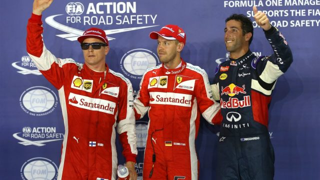 (L to R): Kimi Raikkonen (FIN) Ferrari, pole sitter Sebastian Vettel (GER) Ferrari and Daniel Ricciardo (AUS) Red Bull Racing celebrate in parc ferme at Formula One World Championship, Rd13, Singapore Grand Prix, Qualifying, Marina Bay Street Circuit, Singapore, Saturday 19  September 2015. &copy&#x3b; Sutton Motorsport Images