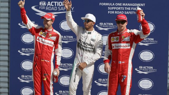 Pole sitter Lewis Hamilton (GBR) Mercedes AMG F1, Sebastian Vettel (GER) Ferrari and Kimi Raikkonen (FIN) Ferrari celebrate in parc ferme at Formula One World Championship, Rd12, Italian Grand Prix, Qualifying, Monza, Italy, Saturday 5 September 2015. &copy&#x3b; Sutton Motorsport Images