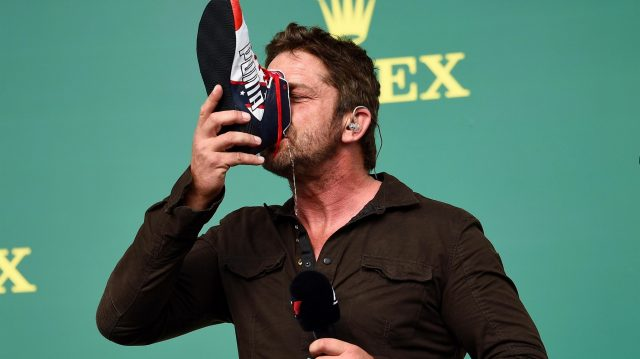 Gerard Butler (GBR) Actor drinks from the boot of Daniel Ricciardo (AUS) Red Bull Racing on the podium at Formula One World Championship, Rd18, United States Grand Prix, Race, Circuit of the Americas, Austin, Texas, USA, Sunday 23 October 2016. &copy&#x3b; Sutton Images