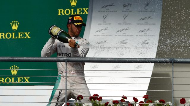 Race winner Lewis Hamilton (GBR) Mercedes AMG F1 celebrates on the podium with the champagne at Formula One World Championship, Rd18, United States Grand Prix, Race, Circuit of the Americas, Austin, Texas, USA, Sunday 23 October 2016. &copy&#x3b; Sutton Images