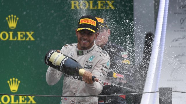 Lewis Hamilton (GBR) Mercedes AMG F1 and Max Verstappen (NED) Red Bull Racing celebrate on the podium with the champagne at Formula One World Championship, Rd20, Brazilian Grand Prix, Race, Interlagos, Sao Paulo, Brazil, Sunday 13 November 2016. &copy&#x3b; Sutton Images