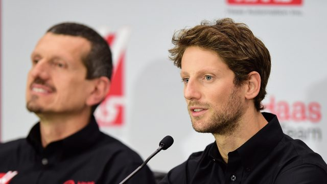 Haas driver Romain Grosjean, with team principal Guenther Steiner in the background &copy&#x3b; 2015 Getty Images