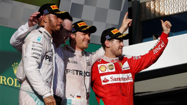 (L to R): Lewis Hamilton (GBR) Mercedes AMG F1, Race winner Nico Rosberg (GER) Mercedes AMG F1 and Sebastian Vettel (GER) Ferrari celebrate on the podium at Formula One World Championship, Rd1, Australian Grand Prix, Race, Albert Park, Melbourne, Australia, Sunday 20 March 2016. &copy&#x3b; Sutton Motorsport Images