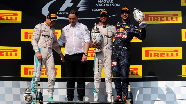 (L to R): Nico Rosberg (GER) Mercedes AMG F1, Ron Meadows (GBR) Mercedes AMG F1 Team Manager, race winner Lewis Hamilton (GBR) Mercedes AMG F1 and Daniel Ricciardo (AUS) Red Bull Racing celebrate on the podium with the trophies at Formula One World Championship, Rd11, Hungarian Grand Prix, Race, Hungaroring, Hungary, Sunday 24 July 2016. &copy&#x3b; Sutton Images