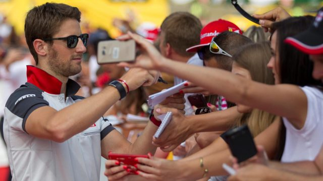 Romain Grosjean (FRA) Haas F1 signs autographs for the fans at Formula One World Championship, Rd11, Hungarian Grand Prix, Race, Hungaroring, Hungary, Sunday 24 July 2016. &copy&#x3b; Sutton Images