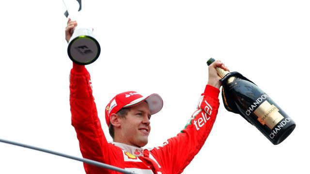 Sebastian Vettel (GER) Ferrari celebrates on the podium with the trophy and the champagne at Formula One World Championship, Rd14, Italian Grand Prix, Race, Monza, Italy, Sunday 4 September 2016. &copy&#x3b; Sutton Images