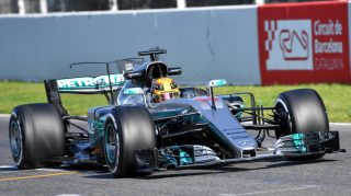 Hamilton tops opening day of testing in Spain