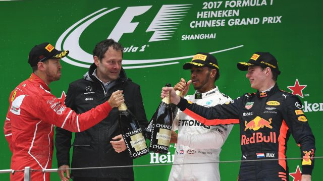 Sebastian Vettel (GER) Ferrari, Aldo Costa (ITA) Mercedes AMG F1 Engineering Director, Lewis Hamilton (GBR) Mercedes AMG F1 and Max Verstappen (NED) Red Bull Racing celebrate on the podium with the champagne at Formula One World Championship, Rd2, Chinese Grand Prix, Race, Shanghai, China, Sunday 9 April 2017. &copy&#x3b; Sutton Motorsport Images