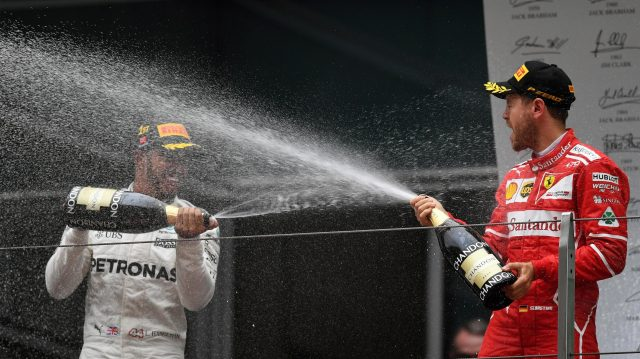 Sebastian Vettel (GER) Ferrari and Lewis Hamilton (GBR) Mercedes AMG F1 celebrate on the podium with the champagne at Formula One World Championship, Rd2, Chinese Grand Prix, Race, Shanghai, China, Sunday 9 April 2017. &copy&#x3b; Sutton Motorsport Images