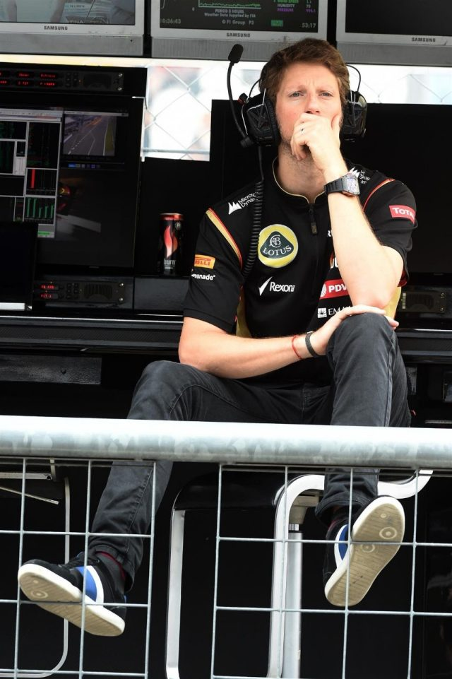 Romain Grosjean (FRA) Lotus F1 on the pit wall gantry in Free Practice One. Formula One World Championship, Rd13, Italian Grand Prix, Monza, Italy, Practice, Friday, 5 September 2014