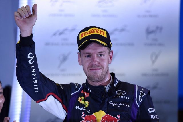 Sebastian Vettel (GER) Red Bull Racing celebrates on the podium. Formula One World Championship, Rd14, Singapore Grand Prix, Marina Bay Street Circuit, Singapore, Race Day, Sunday, 21 September 2014