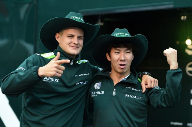 Marcus Ericsson (SWE) Caterham and Kamui Kobayashi (JPN) Caterham with USGP cowboy hats.