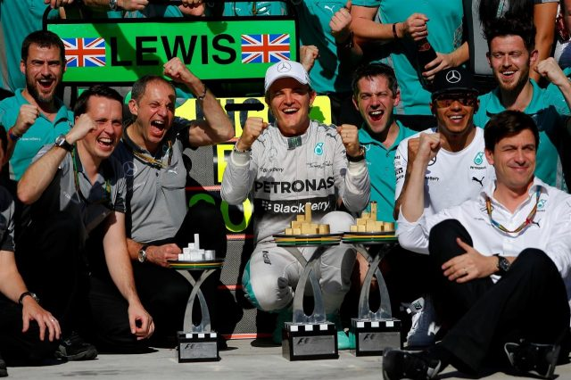 Race winner Nico Rosberg (GER) Mercedes AMG F1 celebrates with second placed Lewis Hamilton (GBR) Mercedes AMG F1, Toto Wolff (AUT) Mercedes AMG F1 Director of Motorsport and the team. Formula One World Championship, Rd18, Brazilian Grand Prix, Race, Sao Paulo, Brazil, Sunday, 9 November 2014