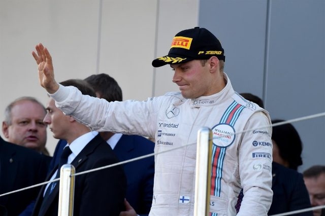 Third placed Valtteri Bottas (FIN) Williams Martini Racing on the podium. Formula One World Championship, Rd16, Russian Grand Prix, Race, Sochi Autodrom, Sochi, Krasnodar Krai, Russia, Sunday, 12 October 2014