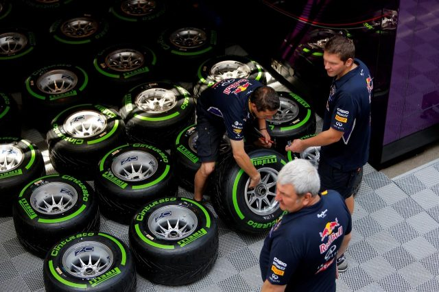 Red Bull Racing mechanics with Pirelli tyres. Formula One World Championship, Rd5, Spanish Grand Prix, Preparations, Barcelona, Spain, Thursday, 8 May 2014