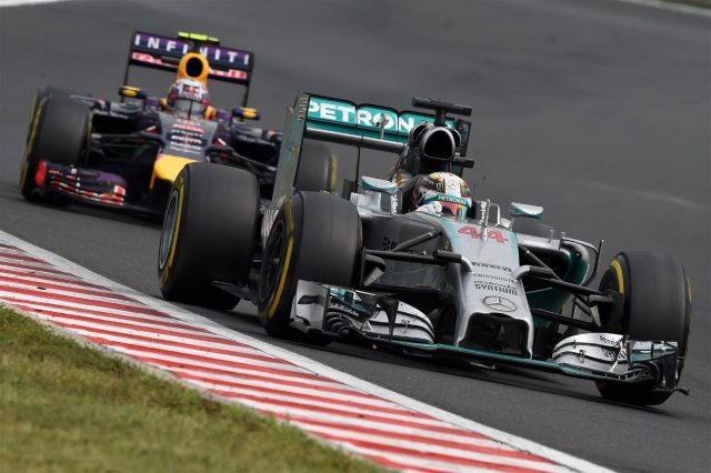Lewis Hamilton (GBR) Mercedes AMG F1 W05 leads Daniel Ricciardo (AUS) Red Bull Racing RB10. Formula One World Championship, Rd11, Hungarian Grand Prix, Race Day, Hungaroring, Hungary. Sunday, 27 July 2014