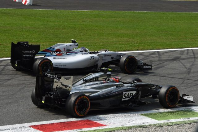 Valtteri Bottas (FIN) Williams FW36 and Kevin Magnussen (DEN) McLaren MP4-29 battle. Formula One World Championship, Rd13, Italian Grand Prix, Monza, Italy, Race Day, Sunday, 7 September 2014