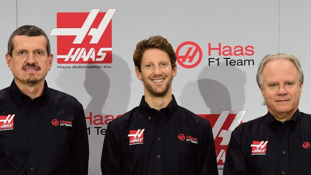 (L-R) Gunther Steiner, team principal of Haas F1 Team, Romain Grosjean of France, and Gene Haas, owner of Haas F1 Team, pose for a photo opportunity after Haas F1 Team announced Grosjean as their driver for the upcoming 2016 Formula 1 season on September 29, 2015 in Kannapolis, North Carolina &copy&#x3b; 2015 Getty Images
