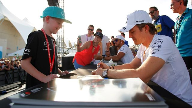 Nico Rosberg (GER) Mercedes AMG F1 signs autographs for the fans at Formula One World Championship, Rd19, Abu Dhabi Grand Prix, Preparations, Yas Marina Circuit, Abu Dhabi, UAE, Thursday 26 November 2015. &copy&#x3b; Sutton Motorsport Images