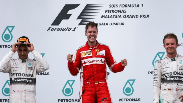 Race winner Sebastian Vettel (GER) Ferrari celebrates on the podium with Lewis Hamilton (GBR) Mercedes AMG F1 and Nico Rosberg (GER) Mercedes AMG F1 at Formula One World Championship, Rd2, Malaysian Grand Prix, Race, Sepang, Malaysia, Sunday 29 March 2015. &copy&#x3b; Sutton Motorsport Images