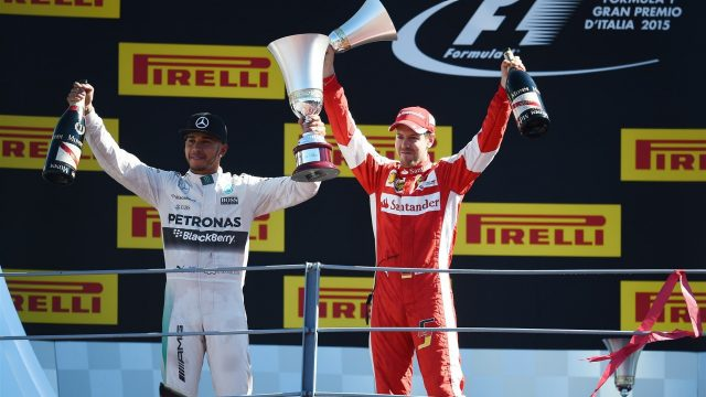 Race winner Lewis Hamilton (GBR) Mercedes AMG F1 and Sebastian Vettel (GER) Ferrari celebrate on the podium with the trophies at Formula One World Championship, Rd12, Italian Grand Prix, Race, Monza, Italy, Sunday 6  September 2015. &copy&#x3b; Sutton Motorsport Images