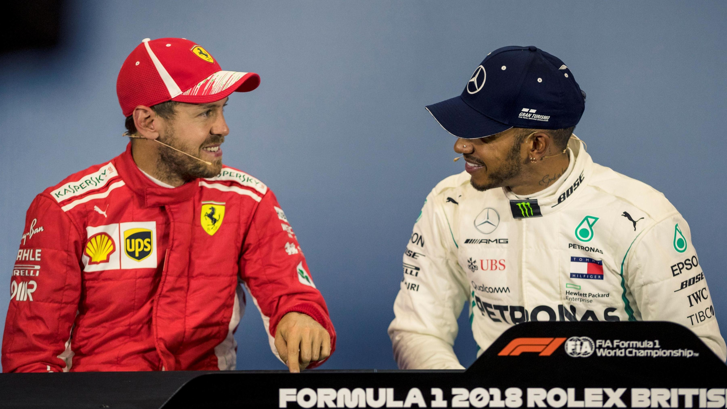 Vettel overcomes pain to hold off Hamilton